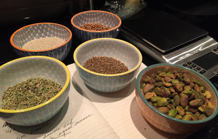 Mise en place, bowls of spices and nuts as I prepare to toast the ingredients